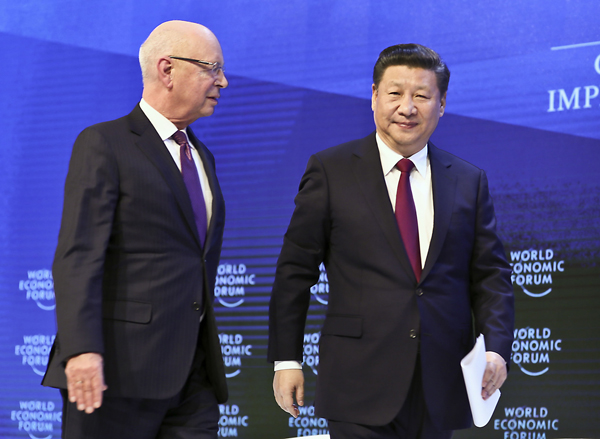 图为习近平主席与世界经济论坛创始人兼执行主席克劳斯·施瓦布。